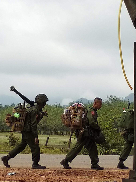 Burma Army soldiers moving to Ta Khee Ko, an old Burma Army position camp on September 11, 2018.