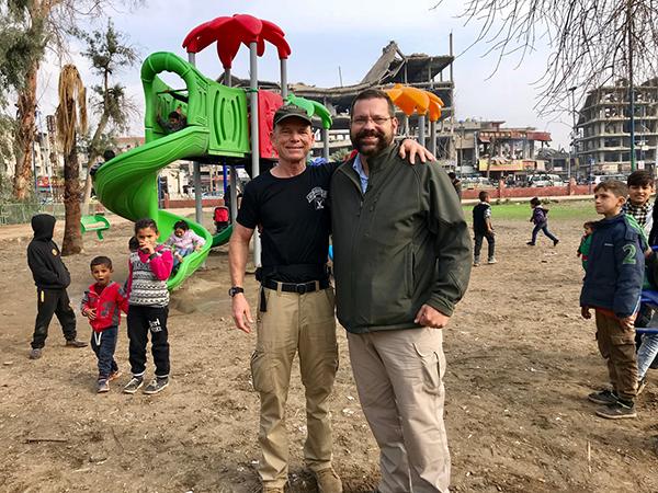 Congressman Garrett and Dave in Raqqa at a Reload Love playground.