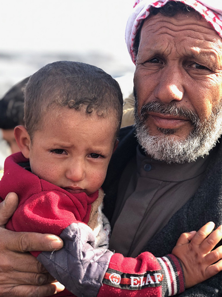 A man with his grandson whose father was killed.