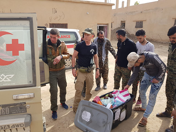 Delivering medicine to the casualty collection point at the Hajin front.