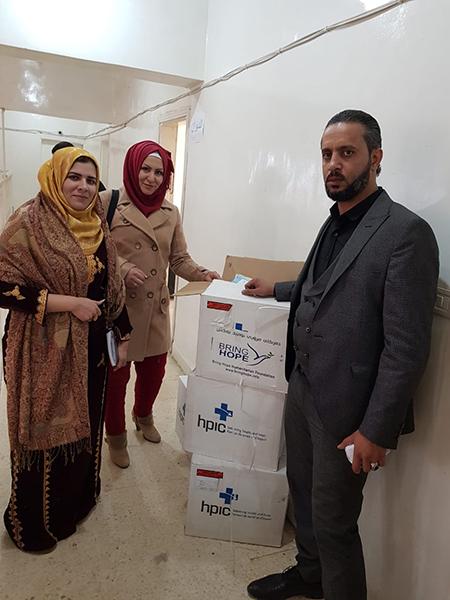 Delivering medicine to the Dier Ezoir civic council.