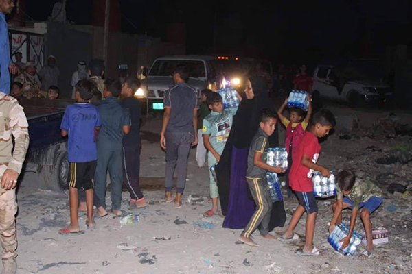 Distributing supplies in Basra