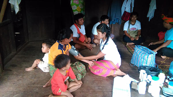 The Pa-Oh Ranger team providing medical support to villagers.