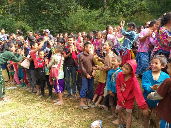 GLC leaders teach the kids new songs.
