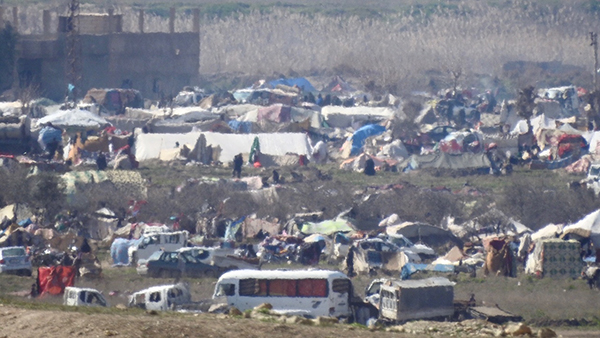 More of the tents and vehicles trapped by ISIS.