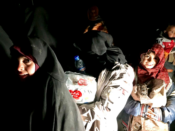 Some of the 1,324 people who fled Baghuz on Feb. 12.