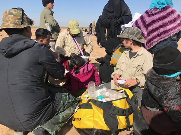 Eliya and Jason, two FBR medics, treat the sick and wounded.
