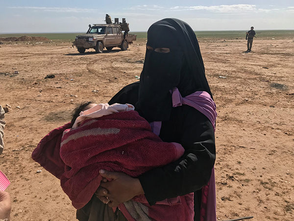 An ISIS mother escapes to SDF lines.