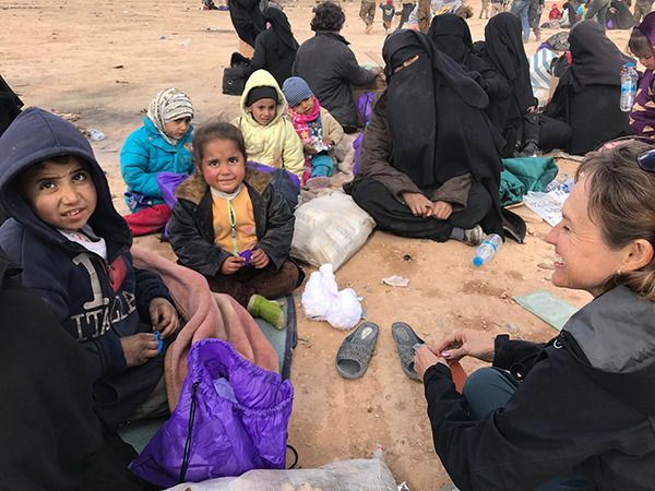 Playing with the children as they wait for a transport to the camps.