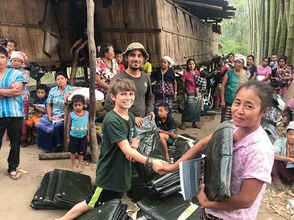 Mohammed and Peter Eubank help distribute tarps to new Karen IDPs in Karen State, Burma (April 2018).
