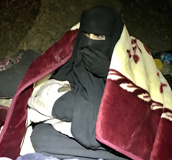 A mother and newborn with blankets delivered at midnight.