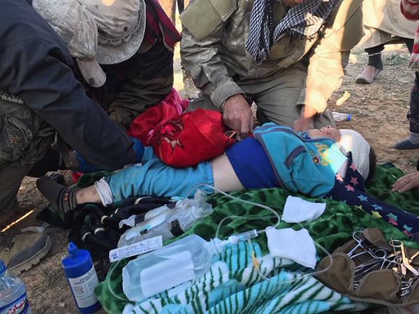 Helping treat an injured child.