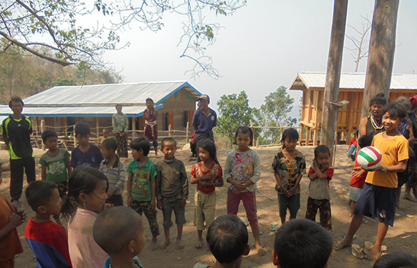 Local kids line up for a game during a program.