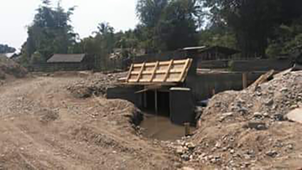 The road and bridge under construction by the Burma Army.