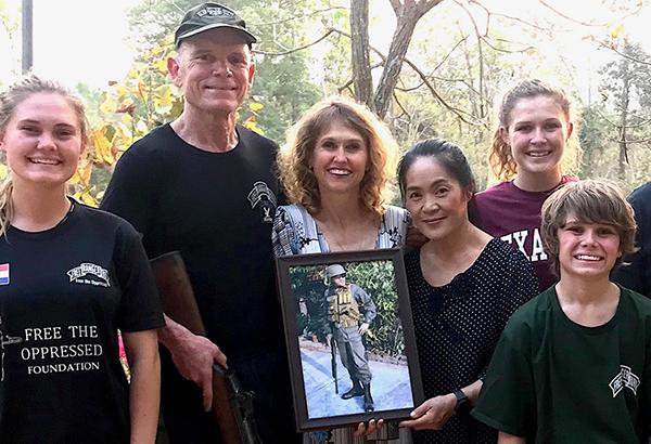 Khun Dawan holding a photo of Col. Prachon.