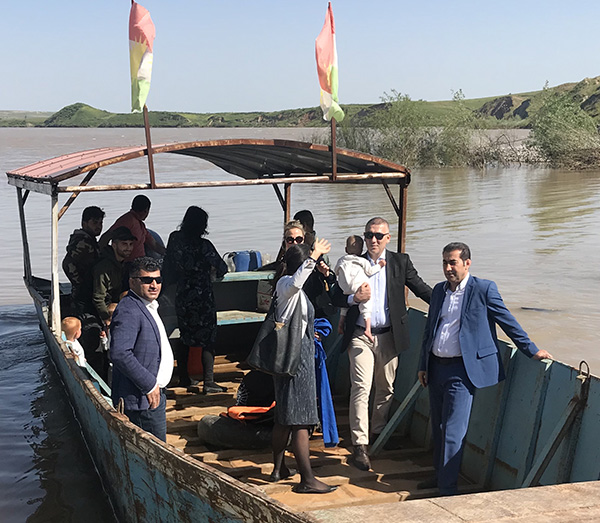 The seven Swedish children crossing the Tigris River from Syria to Kurdistan on their way home.