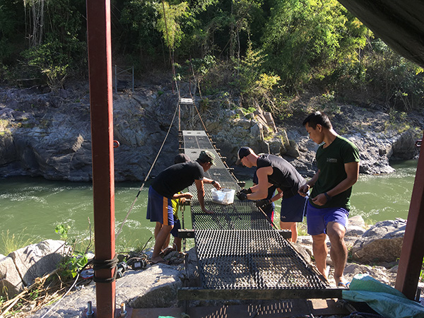 Working on the bridge after it broke during rainy season last year.