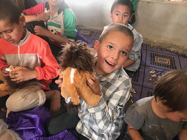 A boy and his new lion from ATP Ministries.