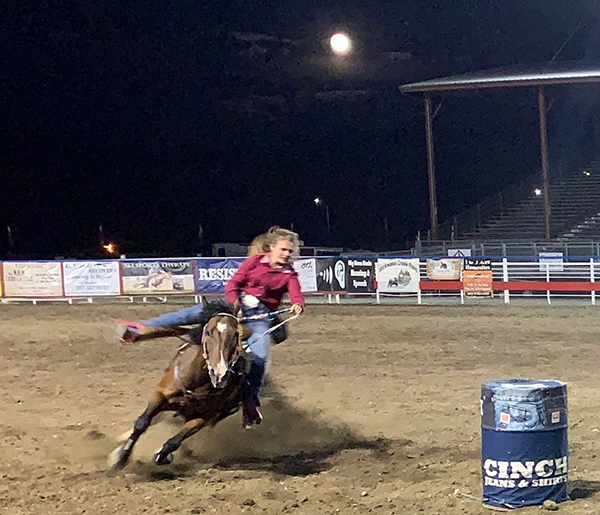 Suu barrel racing at the rodeo.