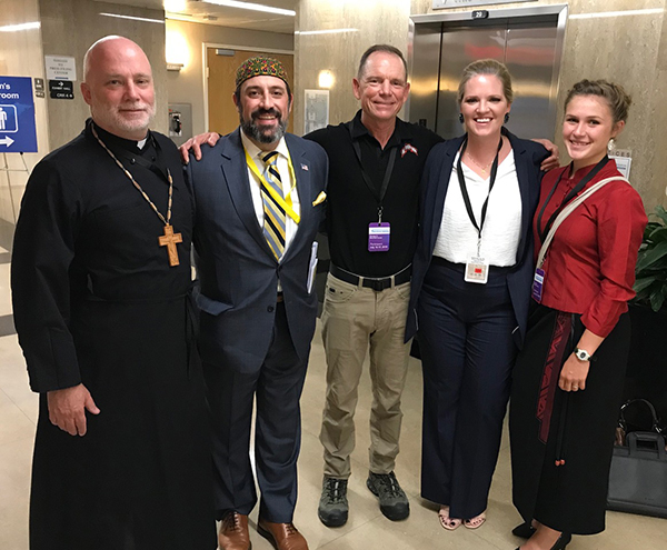 Heather Mercer, Father Ned Anderson, and friends.