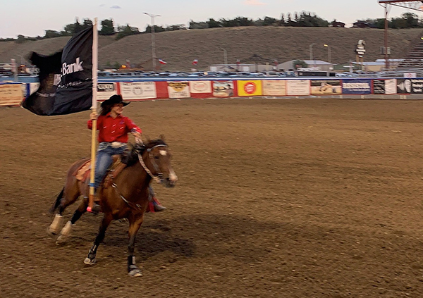 Both Sahale (two photos above) and Suu (immediately above) got to ride as flag girls - an honor and show of their skill!