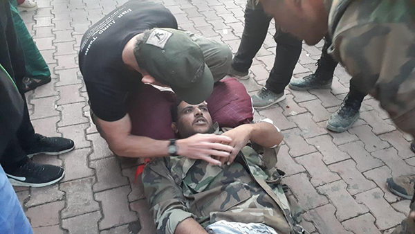 Praying with the wounded Syrian Army soldier before he was transported to Qamishli.