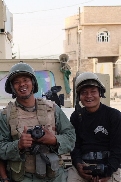 Zau, at left, pictured with fellow cameraman, Monkey, in Mosul, Iraq.