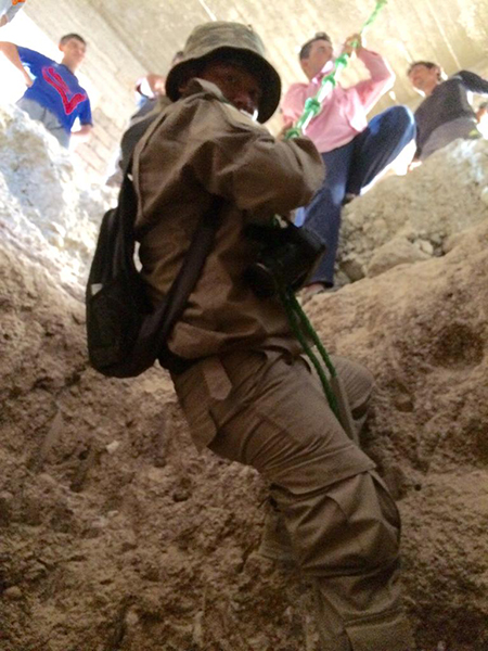 Zau Seng enters an ISIS tunnel during the operation to clear ISIS from Mosul