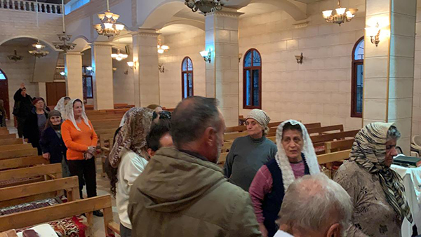 Some of the last remaining Christians in Tel Tamir - click the photo to see video from the church.