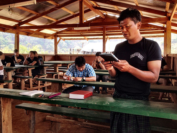 Zau Seng reading scripture during Tah U Wah training camp.