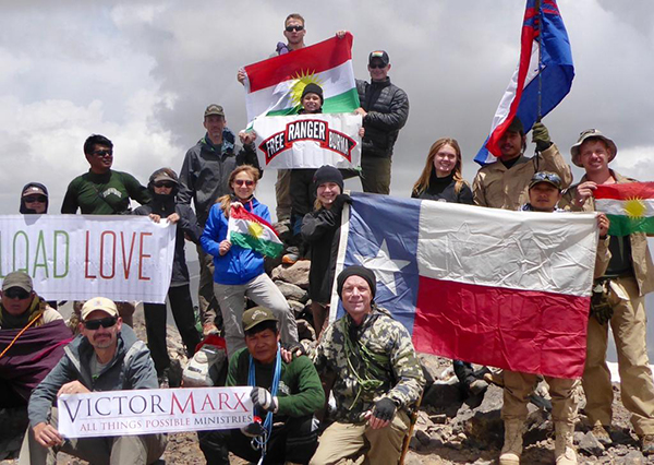 Zau Seng, in the back left corner, with the team on the highest mountain in Iraq