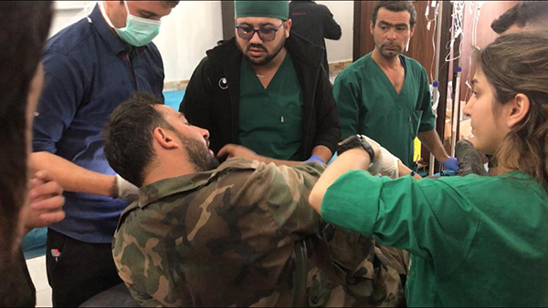 Staff at Tel Tamir Hospital treating wounded Syrian Army soldiers who were hit by Turkish/FSA mortars on Nov. 9.