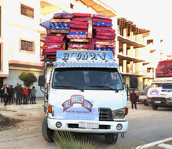 A truck full of mattresses for displaced families.