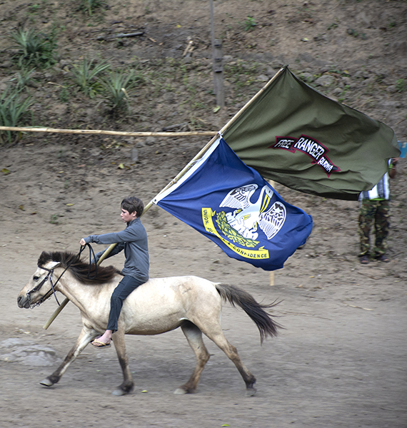 Peter Eubank helps open the ceremony by carrying in the FBR and Louisiana flags