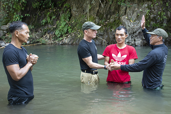 Dave Eubank and Pastor Edmond baptize Ray Khin, a medic from the Jungle School of Medicine-Kawthoolei