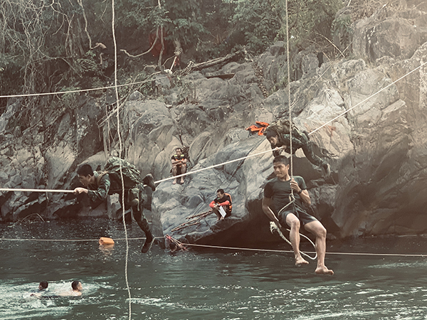 Rangers rappelling, swimming, and crossing the river