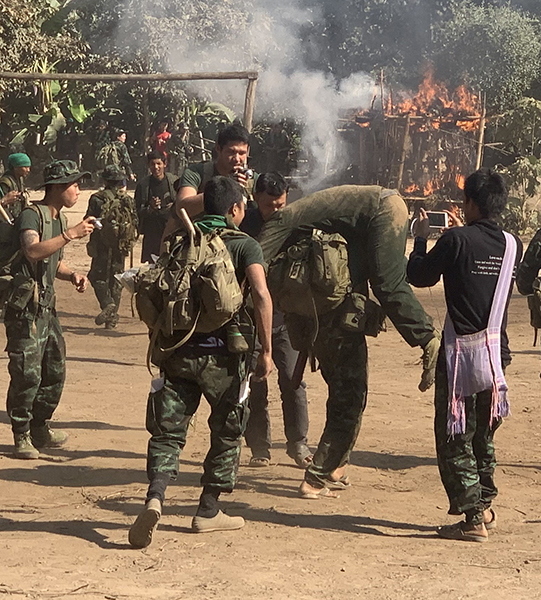 Rangers practice evacuating villagers during a village-attack simulation