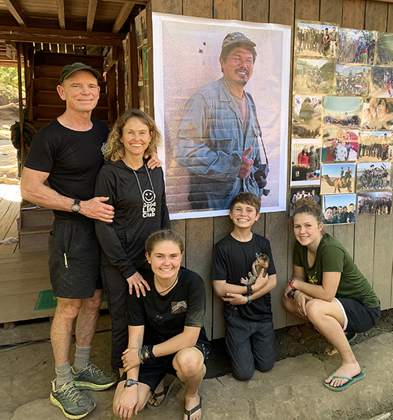 The Eubank family at the new Zau Seng memorial wall at their TUW Camp home