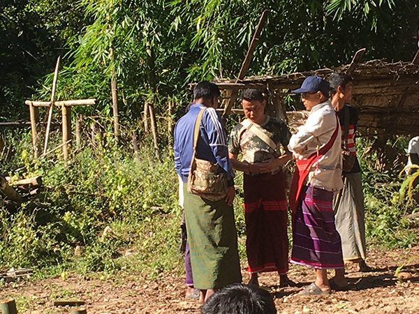 Lt. Col. San Lin Aung of IB 53 (pictured at left in the blue shirt) and Lt. Col. Htin Lin Aung of LIB 589 (pictured in the back in the green and tan shirt) meet with villagers in the Pa Kaw Hta area.