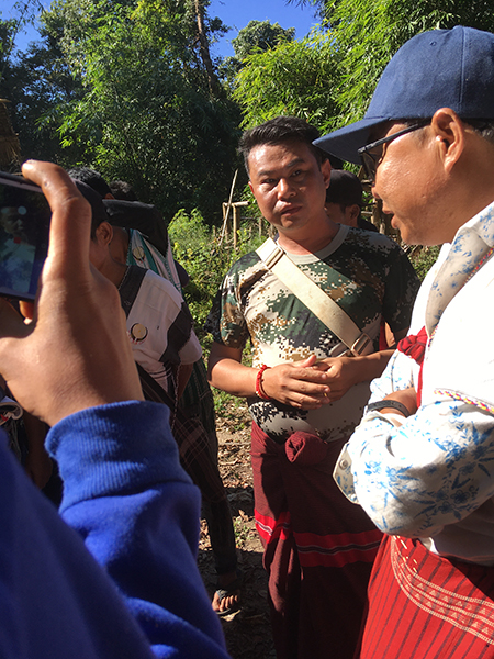 Burma Army Lt. Col. Htin Lin Aung listening to villagers at the Nov. 18 protests.