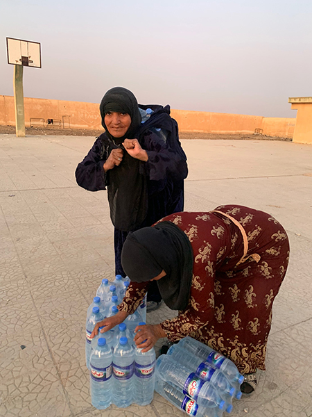 Families getting ready to head out with their water.