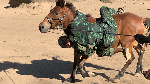 A ranger tests his new horse-riding skills