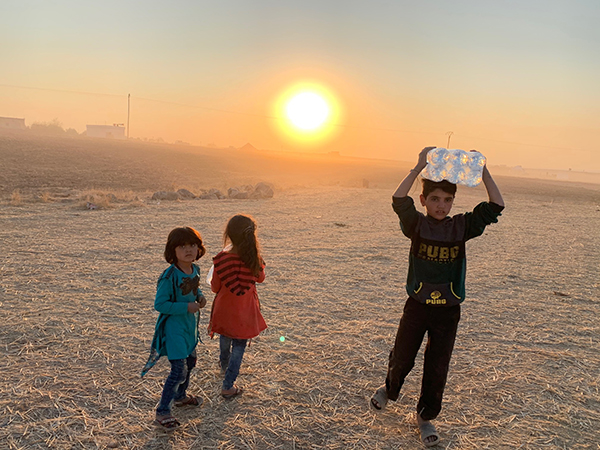 Giving water to families in the desert.