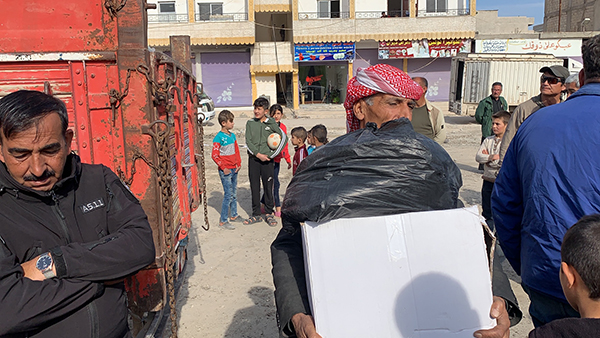 Families receive supplies.