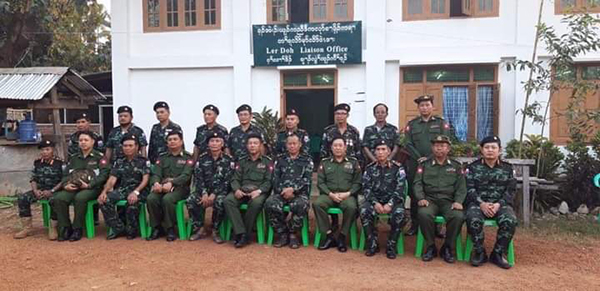 Burma Army officials (in solid green) and Karen leaders (in camo) who attended the meeting