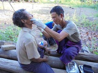 A Ranger provide dental care during the mission