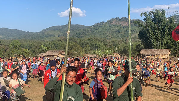 Rangers carrying flags as they run with the villagers