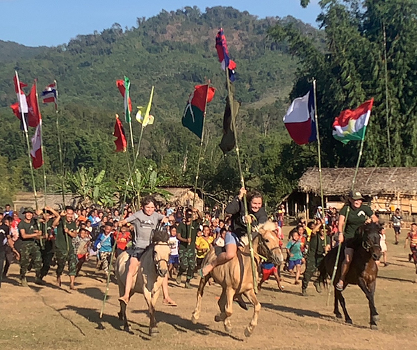 Running across the field. The Burma Army camp is on the mountain in the background.
