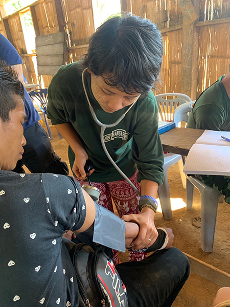 A medic checking a villager during the medical clinic