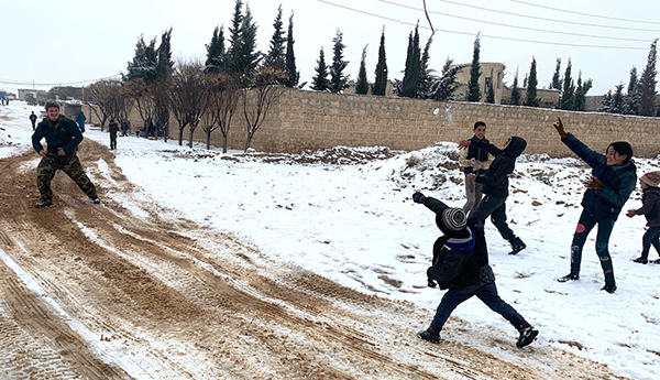 Snowball fight with Idlib kids